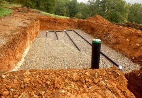 Bottom layer of pipework laid on gravel in the construction of a